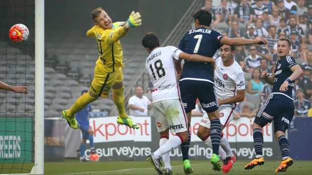 Victory's Besart Berisha (right) beats Wanderers' goalkeeper Andrew Redmayne to put his team ahead.