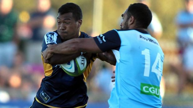 The Brumbies' Aidan Toua tries to bust through Reece Robinson's defence.