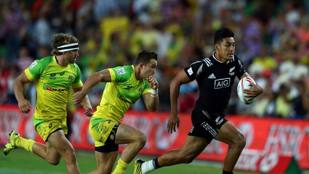 Rieko Ioane of New Zealand races away for a try during New Zealand's pool match against Australia.