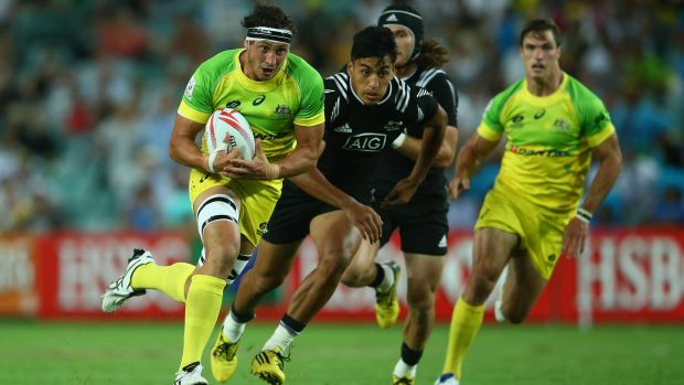 Super Sevens: Sam Myers of Australia makes a break during the match between Australia and New Zealand.