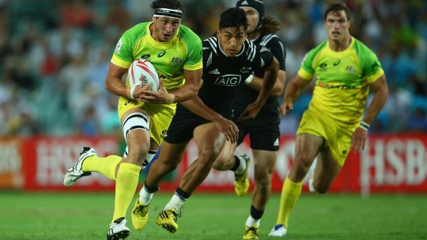 Sam Myers makes a break during the match between Australia and New Zealand.