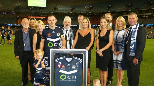 Leigh Broxham of the Victory poses for a photo after a presentation to mark his 200th game.