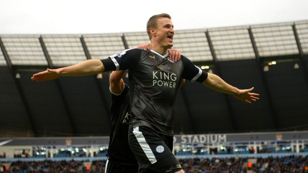 Leicester's Robert Huth celebrates scoring his team's third goal against Manchester United.