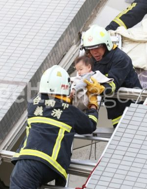 A baby is rescued from a collapsed apartment.
