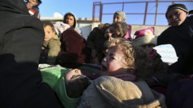 Syrians fleeing Russian air strikes arrive at the Bab al-Salam border crossing with Turkey.