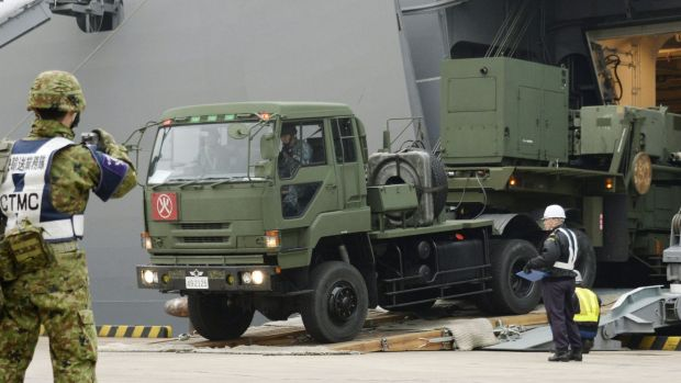 A vehicle carrying a PAC-3 missile interceptor arrives at a port on Ishigaki Island, southwestern Japan on February 6.