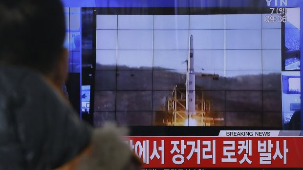 A South Korean man watches a TV news  report on North Korea's rocket launch at Seoul Railway Station.