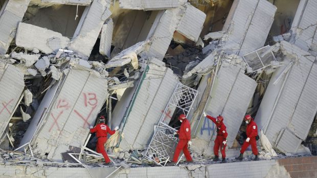 Emergency rescuers continue to search for missing in a collapsed building from an earthquake in Tainan, Taiwan.