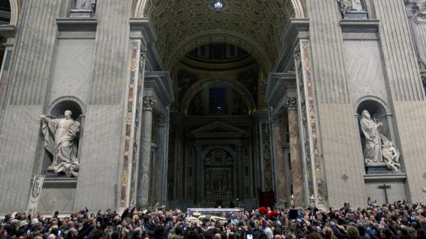 "The corpse of Saint Pio da Pietralcina, also known as ""Padre Pio"", is carried inside St Peter's Basilica on Friday."