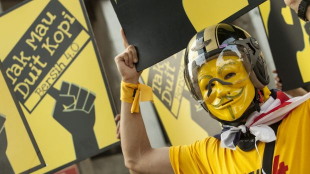 A masked anti-government protester during the Bersih (Clean) 4.0 rally in Kuala Lumpur, Malaysia in August last year.