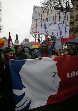 "A protester holds a banner reading ""Stop the state of emergency"" in Paris."