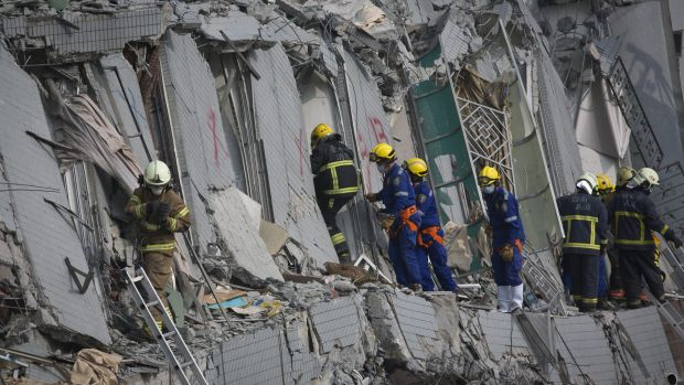 Rescue personnel search for survivors in the Wei Guan building in Tainan, southern Taiwan.
