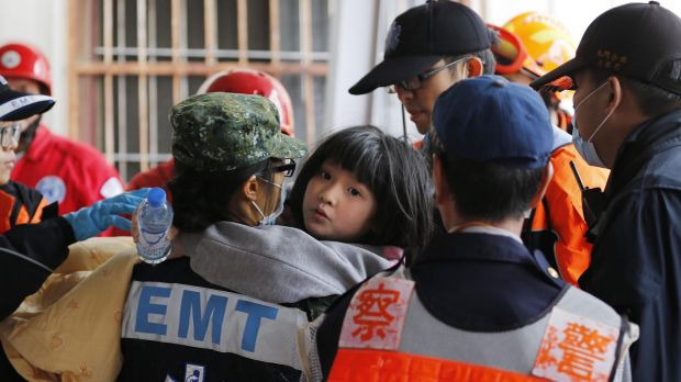 A girl is rescued from the Wei Guan building.