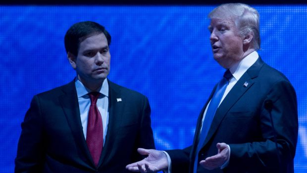 Donald Trump and Marco Rubio (left) speak during a break in the debate.