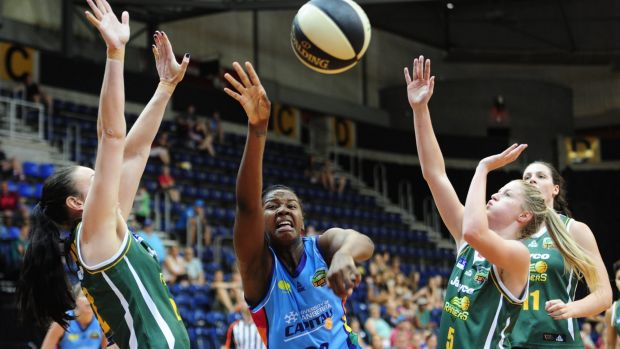 Canberra Capitals  player Denesha  Stallworth fights for a loose ball against Dandenong last week.