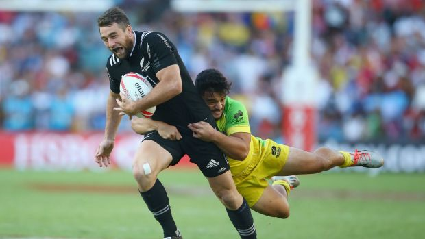 Joe Webber of New Zealand is tackled by Allan Fa'alava'au of Australia during the final.