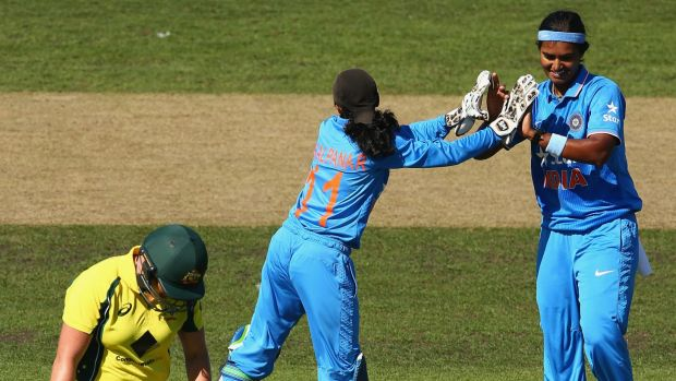 Long walk: Australia's Grace Harris trudges off after being dismissed by India's Shikha Pandey.