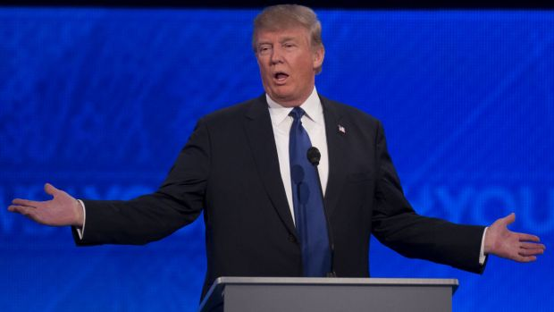 Proud outsider: Donald Trump is booed at the New Hampshire debate after attacking Jeb Bush.