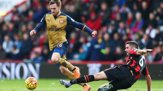 Aaron Ramsey is challenged by Bournemouth's Andrew Surman.