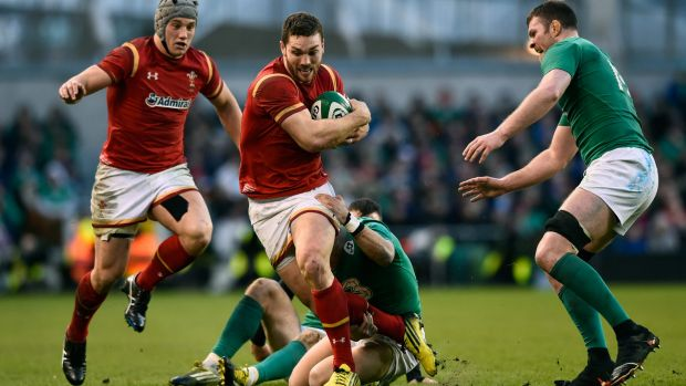 George North crashes through the Irish defence at the Aviva Stadium on Sunday.