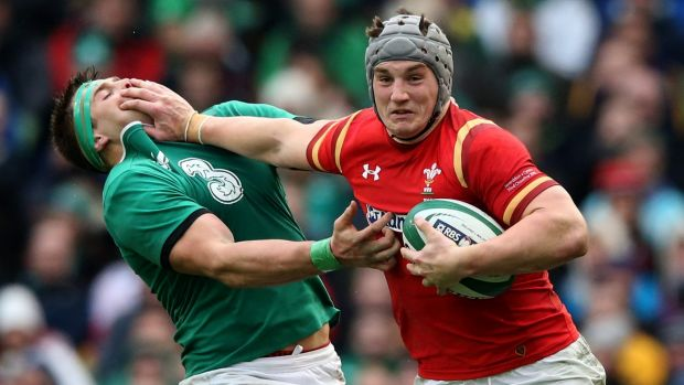 Jonathan Davies buses off CJ Stander during Wales' Six Nations opener against Ireland on Sunday.