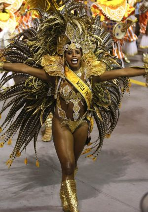 A dancer from the Unidos do Peruche samba school performs during a carnival parade in Sao Paulo, Brazil.