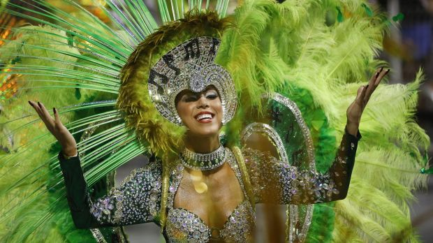 A dancer in an elaborate costume joins the carnival parade in Sao Paulo.