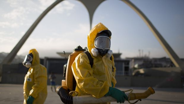 Health workers stand in the Sambadrome in Rio de Janeiro to spray insecticide.