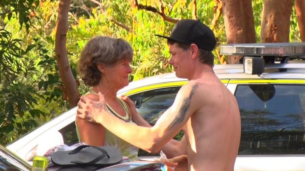 Nick Weston comforts the mother of a man who fell to his death at Somersby Falls.