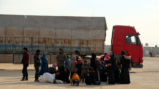 Syrians fleeing conflict in the Azaz region stand outside the Bab al-Salam border gate on Friday.