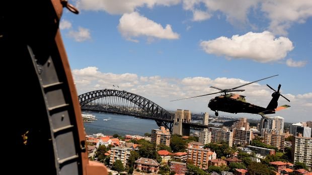 One of two Black Hawk helicopters from the Australian Army's 6th Aviation Regiment fly over Sydney Harbour during a ...
