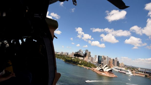 Fast and durable: An aircraft manned by special forces officers flies over Sydney.