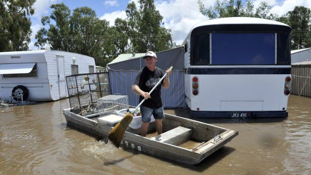 Paul Crawford uses a boat during the Bridgewater flood in January 2011.