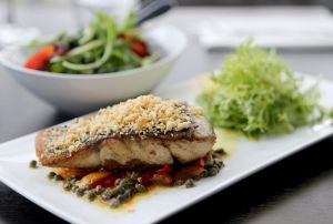 The Barramundi with side salad at Riva