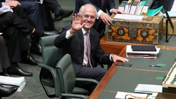 Prime Minister Malcolm Turnbull waves during question time on Monday.