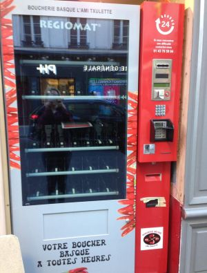 """The 24-hour meat vending machine outside the """"l'ami Txulette"""" butcher shop in Paris just before it was stocked and open ..."""