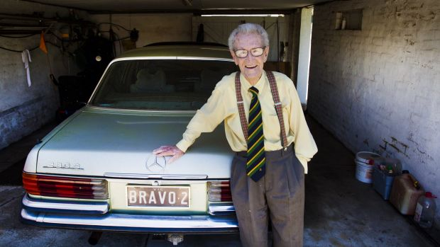 100-year-old Norm Bravo with his Mercedes-Benz — registration BRAVO 2.
