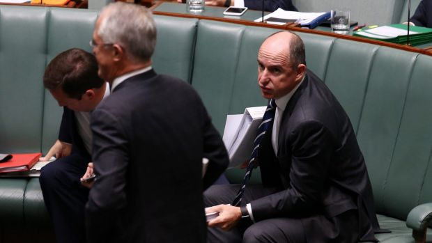 Prime Minister Malcolm Turnbull passes minister Stuart Robert at the end of question time on Monday.