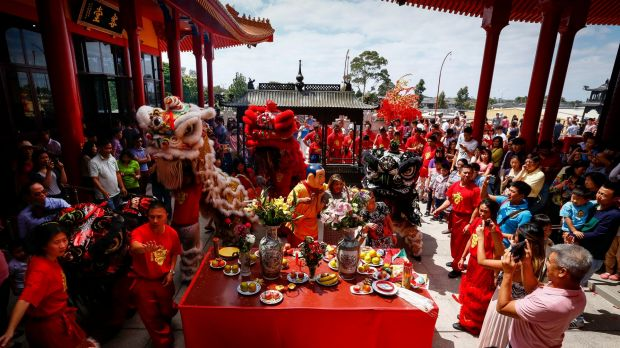 Food offerings and the lion dance for 2016 Lunar New Year celebrations at Bright Moon Buddhist temple in Springvale South.
