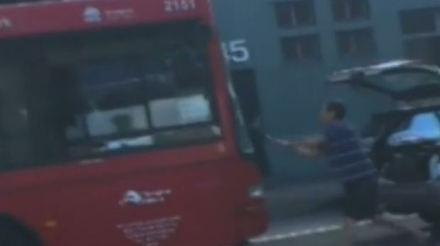 The moment an enraged driver took to the bus with a shovel.