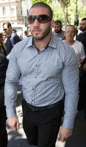 Kickboxer Suleiman Abdulrahim charged over Reservoir crash that killed elderly woman seen here leaving the Melbourne ...