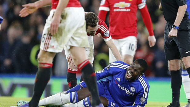 Huge blow: Chelsea's Kurt Zouma clutches his knee after tearing his ACL.