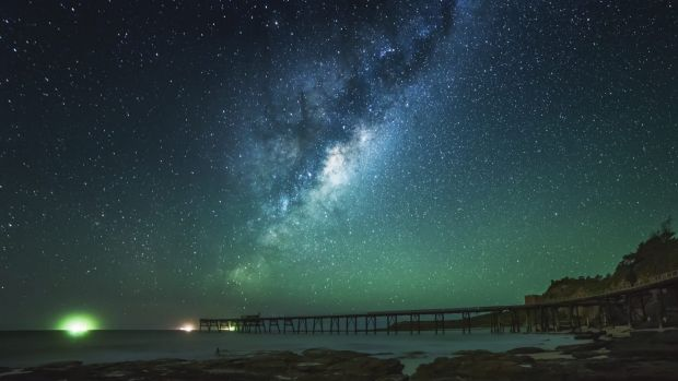 Hundreds of galaxies have been discovered hiding behind the glowing disk of the Milky Way. This photo was taken at ...