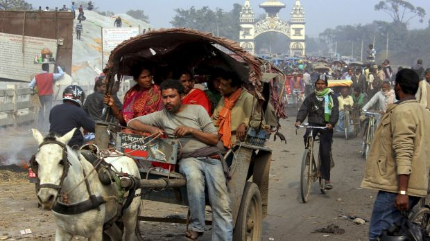 Local residents of Nepal and India cross a bridge at Birgunj on Friday. Vehicles have passed through the main border ...