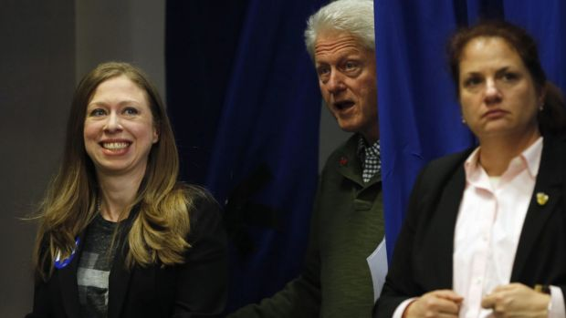 A family affair: former president Bill Clinton and his daughter Chelsea Clinton walk to the stage during a campaign stop ...