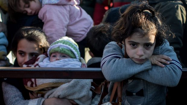 A young girl waiting in line on Monday  to pass through a border gate as a small number of Syrian refugees were allowed ...