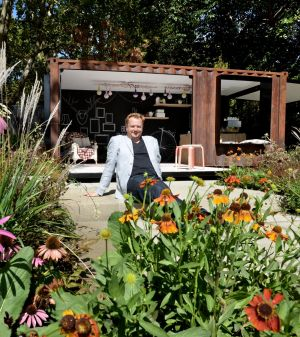 "Designer Ian Barker in his garden called ""Left Overs"" at the 2014 Melbourne Garden and Flower show."