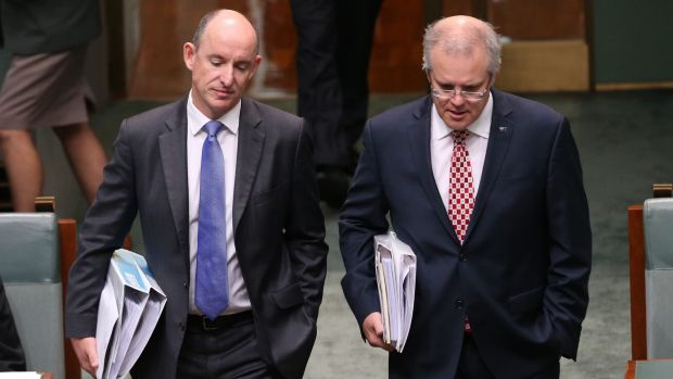 Human Services Minister Stuart Robert and Treasurer Scott Morrison arrive for question time on Tuesday.