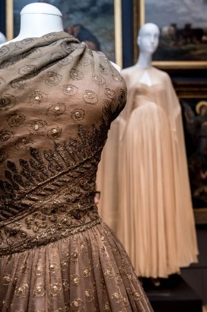 A dress by Christian Dior, left, and one by Gres in the NGV's new collection.