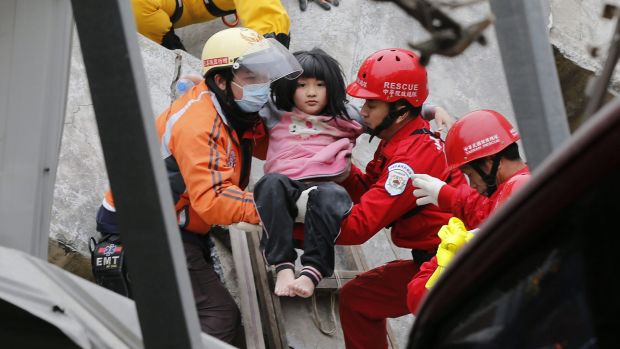 Eight-year-old Lin Su-Chin rescued from a collapsed building after an earthquake in Tainan.